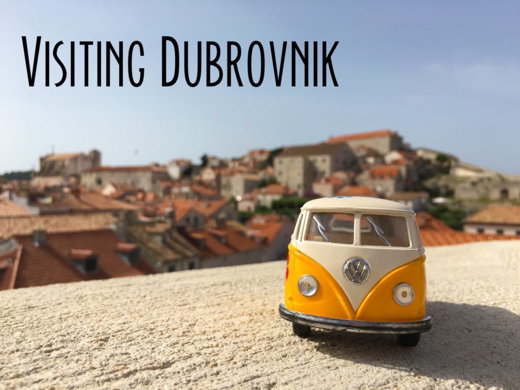 The yellow van in Dubrovnik with the red tile roofs