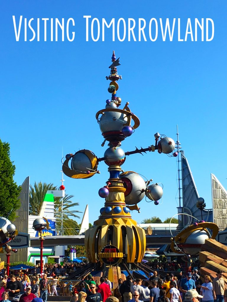 Title card showing the tomorrowland astro orbiters and the text visiting tomorrowland.