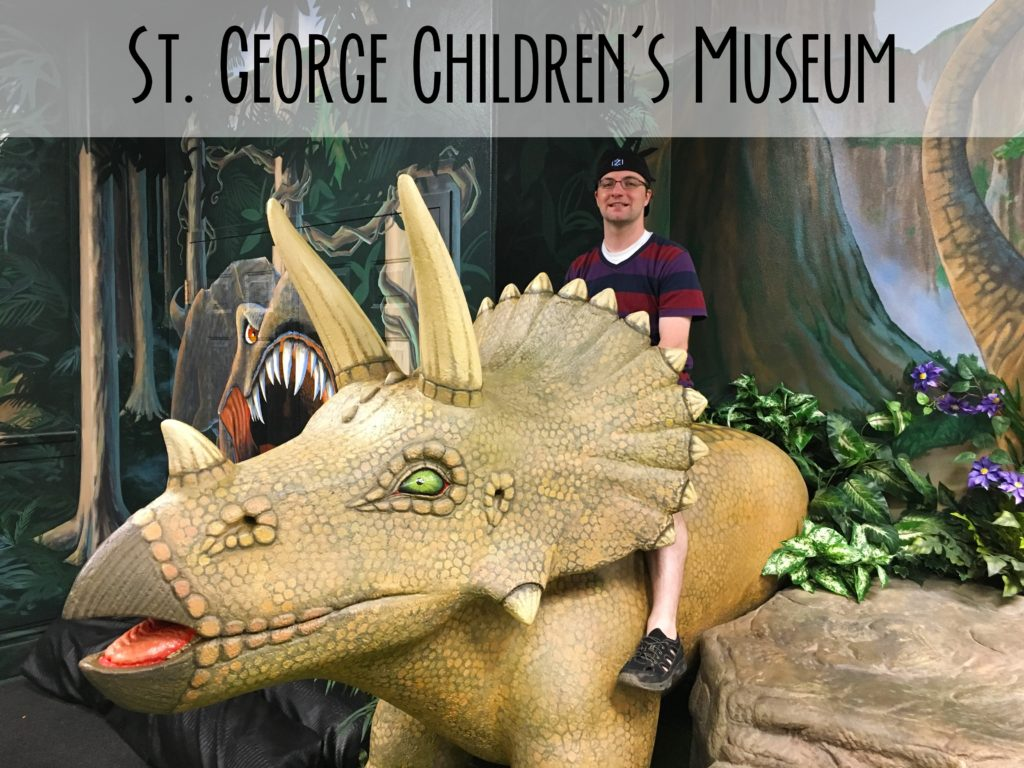 Title image showing Ben on a triceratops with the words St. George Children's museum