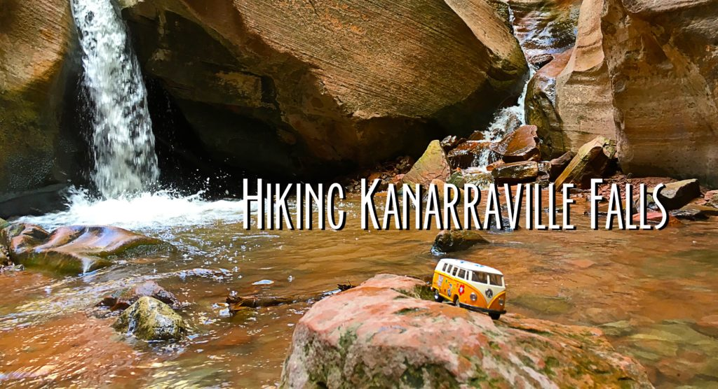 Title card showing the yellow van in front of a 15 foot waterfall