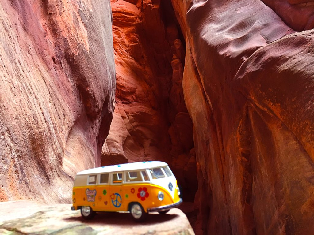 The yellow van in a gorgeous red slot canyon
