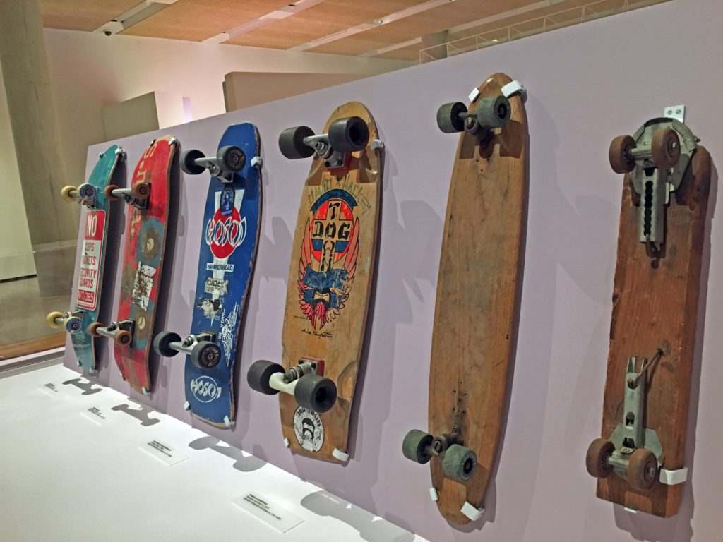 a lineup of skateboards in the California: Designing Freedom exhibit
