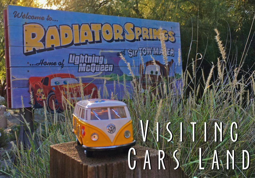 Title Card showing yellow van with Cars Land Sign