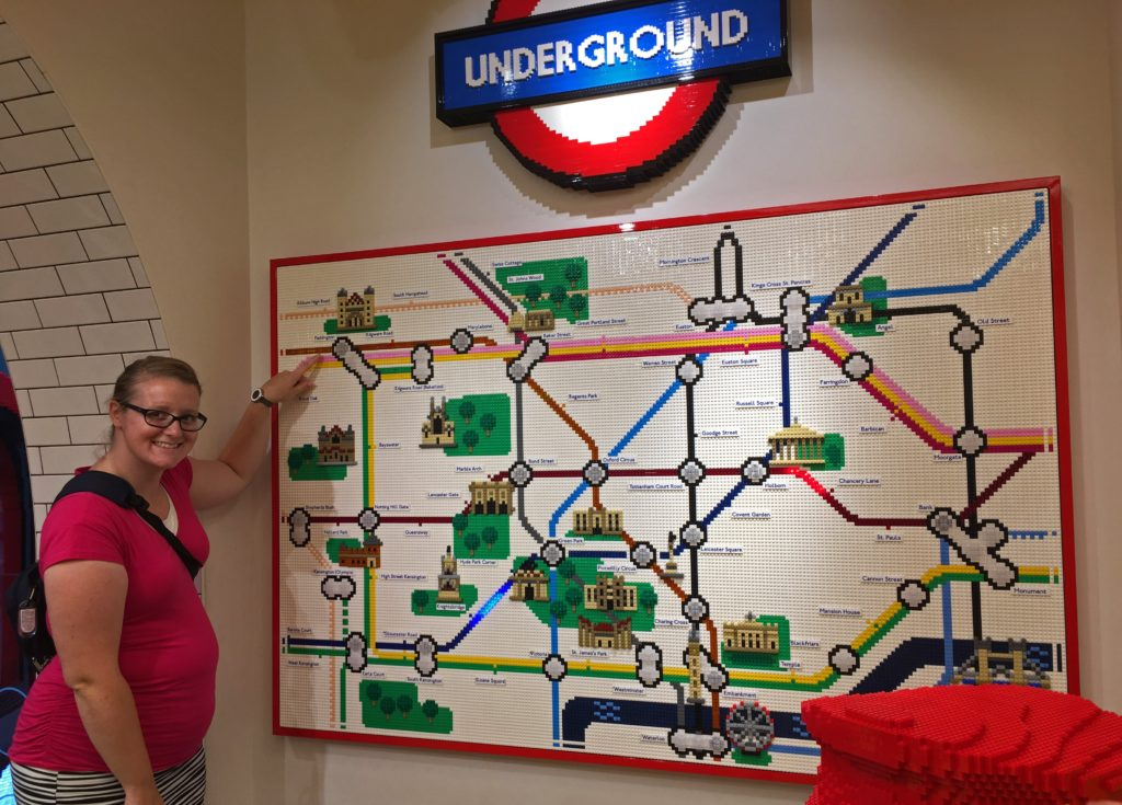 Meagan with a London Tube map made out of Legos